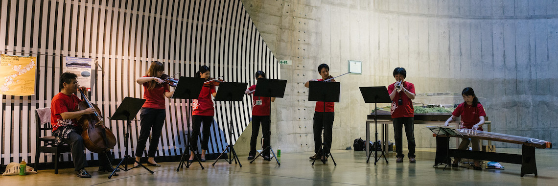 OIST employees and students performing music in the tunnel gallery