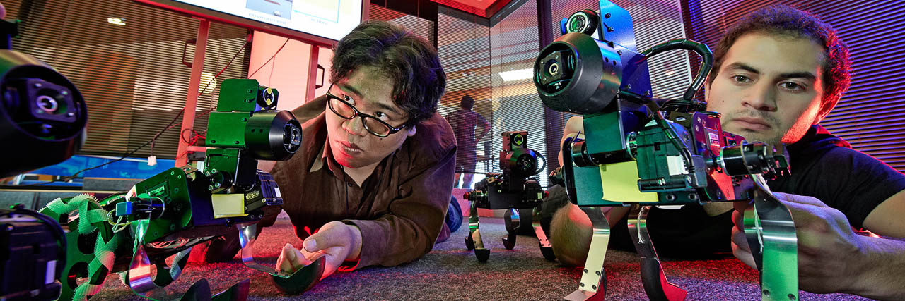 Researchers in the Doya robot lab