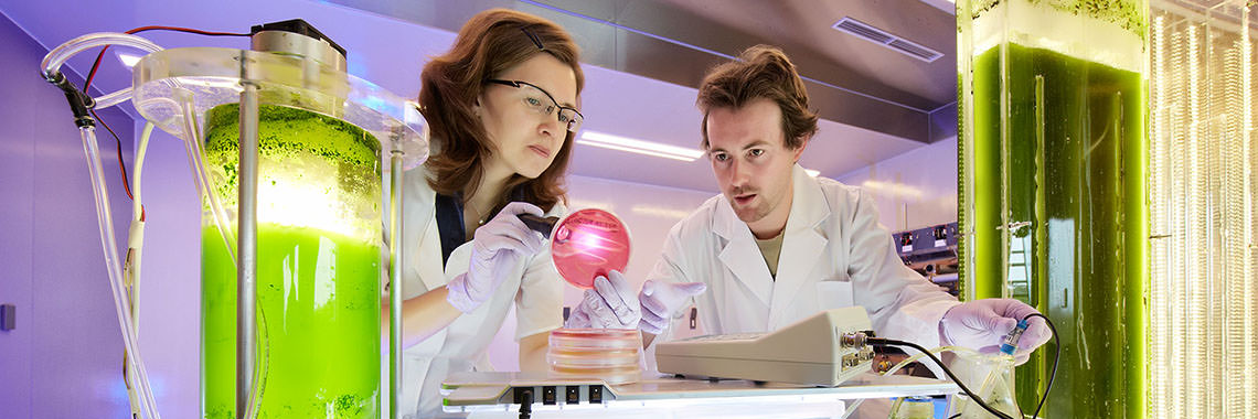 Photo of male and female researchers in lab