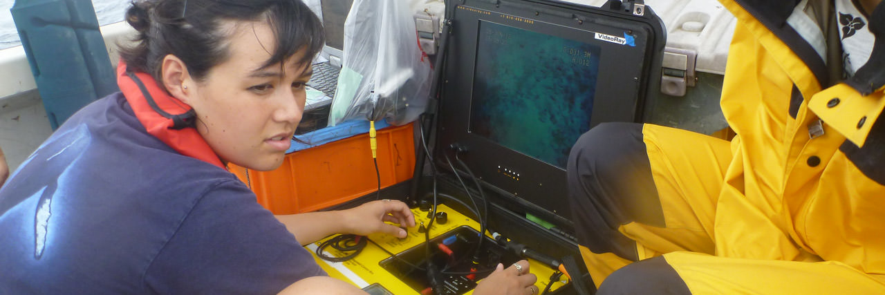 Student on boat with marine equipment